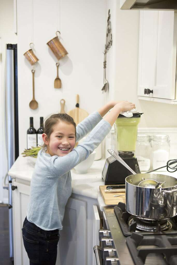 Wiebke Liu's daughter Josie helps mom prepare lunch with one of Liu's mixes that she creates from scratch. Photo: Vivian Johnson, Special To The Chronicle