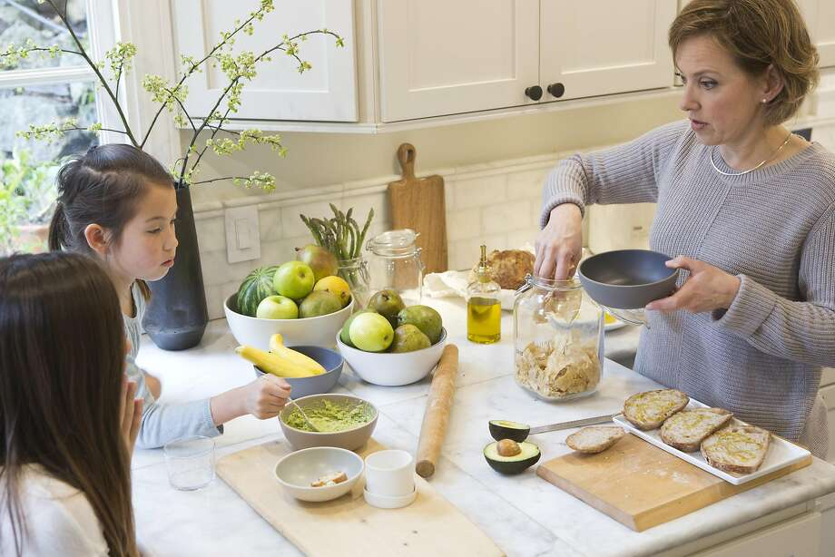 Wiebke Liu and her daughters Mia and Josie prepare lunch with Liu's mixes that she creates from scratch. Photo: Vivian Johnson, Special To The Chronicle