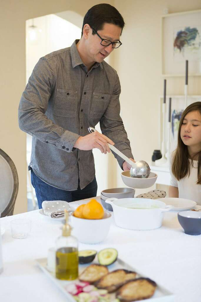 Wiebke Liu's husband, Fred, dishes up soup made by his daughters from a mix Liu created from scratch. Photo: Vivian Johnson, Special To The Chronicle