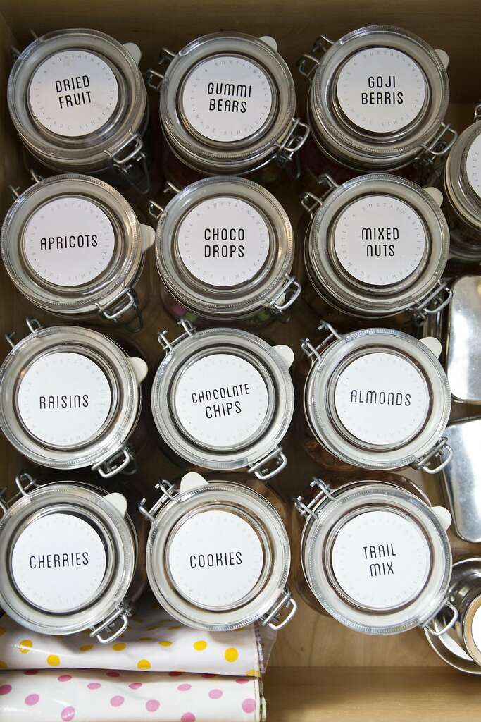 Wiebke Liu uses uniform storage jars and labels to organize her kitchen. Photo: Vivian Johnson, Special To The Chronicle