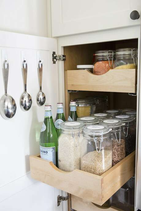 Wiebke Liu, creator of Blisshaus, helps families organize their kitchen by using jars. Photo: Vivian Johnson, Special To The Chronicle