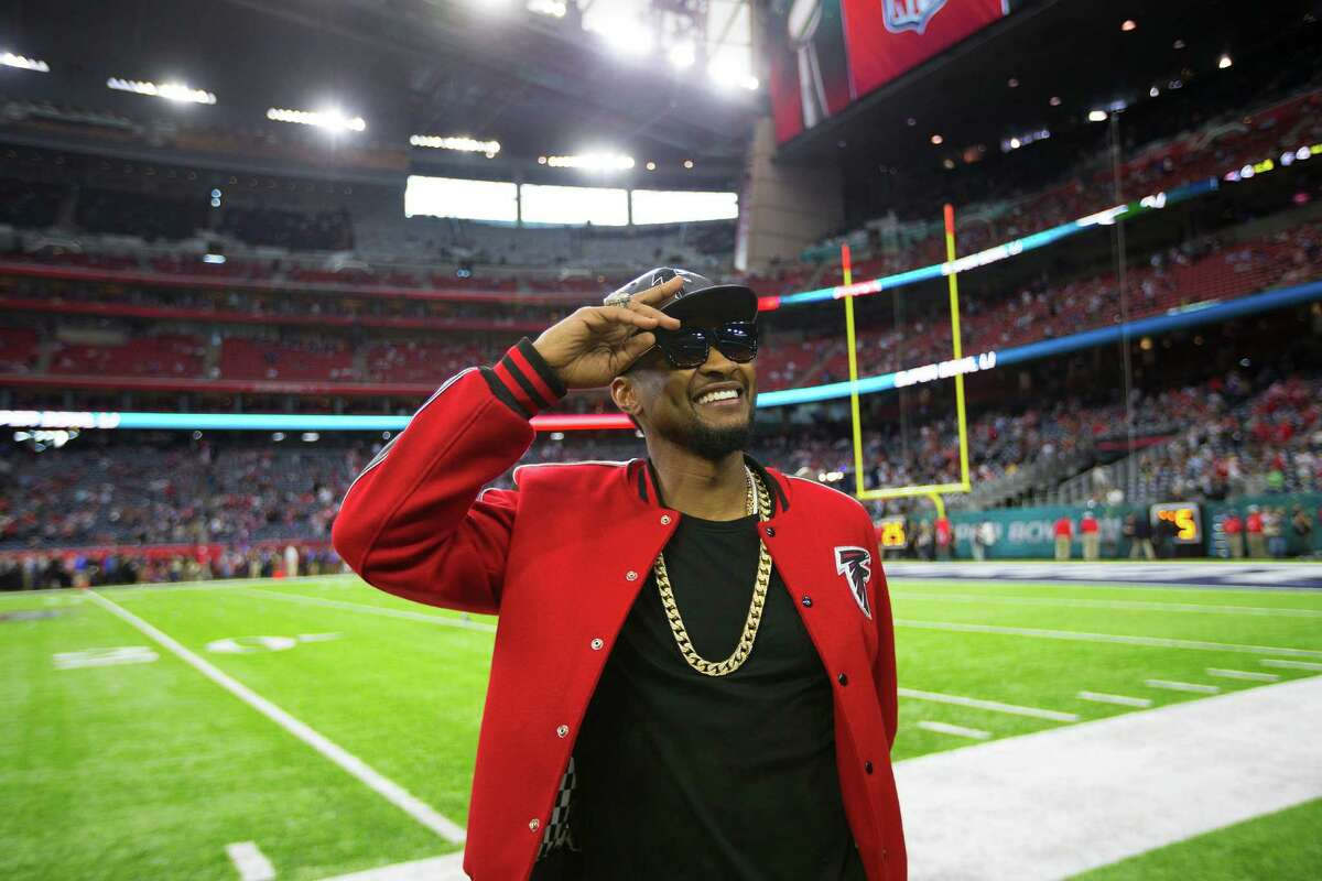 Usher stands on the sidelines before Super Bowl LI at NRG Stadium on Sunday, Feb. 5, 2017, in Houston.
