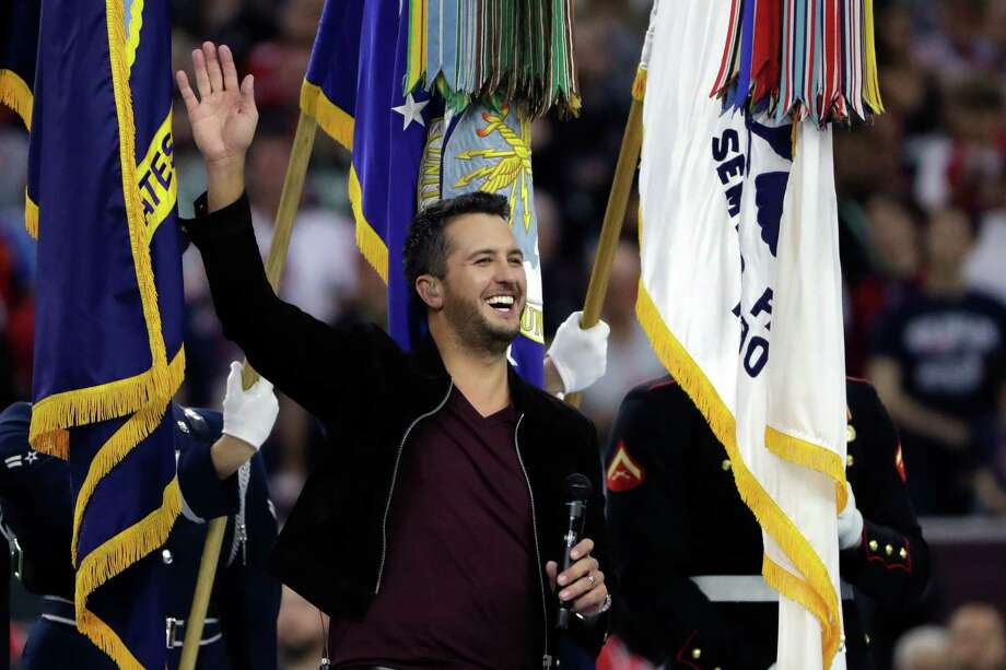 Game dayCountry music artist Luke Bryan waves on the field to sing the national anthem before the NFL Super Bowl 51 football game between the New England Patriots and the Atlanta Falcons Sunday, Feb. 5, 2017, in Houston.Click through to see what other festivities are hitting Houston for Super Bowl LI. Photo: Matt Slocum, Associated Press / Copyright 2017 The Associated Press. All rights reserved.
