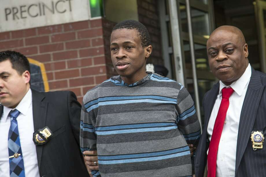 FILE — Detectives lead Chanel Lewis out of the 107th Precinct station house in New York, Feb. 5, 2017. Lewis was arrested in the murder of Karina Vetrano, who was strangled last summer on a secluded park path in nearby Howard Beach, Queens, the police said on Sunday. The Police DepartmentÕs chief of detectives, Robert Boyce said Lewis gave the police a DNA sample on Thursday night, that matched DNA found on Vetrano. Photo: ULI SEIT, NYT