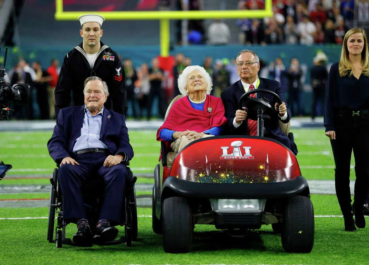 Former President George Bush and his wife Barbara Bush during the pregame ceremonies for Super Bowl LI at NRG Stadium on Sunday, February 5, 2017.