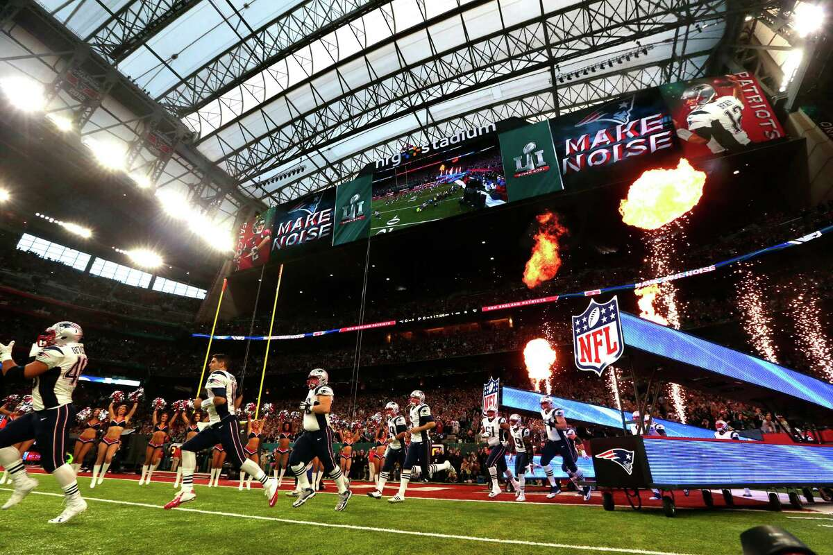 New England Patriots players head onto the field before Super Bowl LI at NRG Stadium on Sunday, Feb. 5, 2017, in Houston.