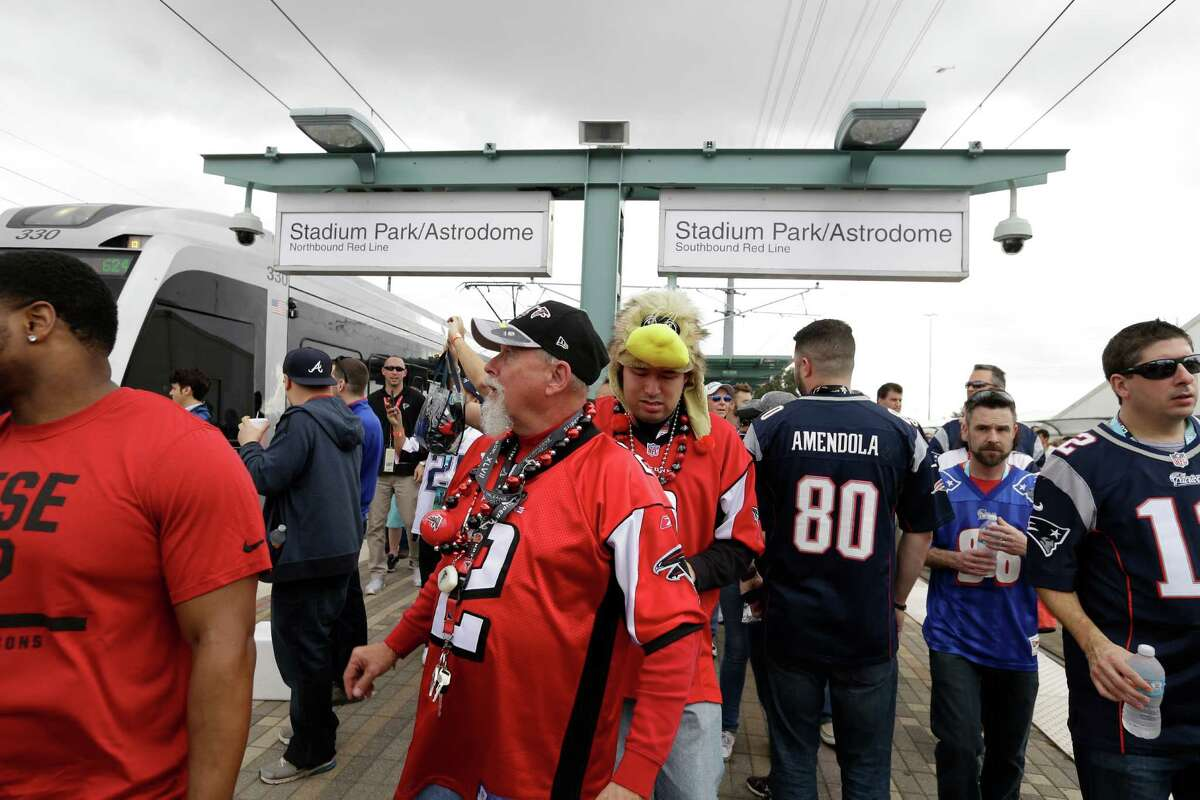 Fans arrive by Metro rail to NRG Stadium for Super Bowl Sunday, Feb. 5, 2017, in Houston.