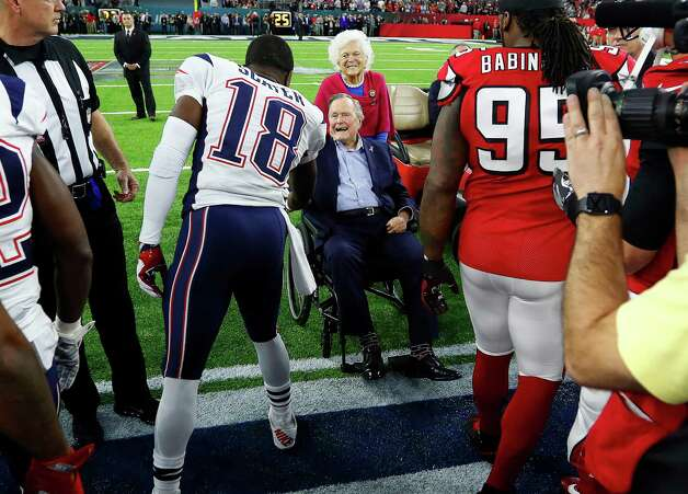 New England Patriots wide receiver Matthew Slater left, greets Former President George Bush and his wife Barbara Bush during the pregame ceremonies for Super Bowl LI at NRG Stadium on Sunday, February 5, 2017. Photo: Karen Warren, Houston Chronicle / 2017 Houston Chronicle