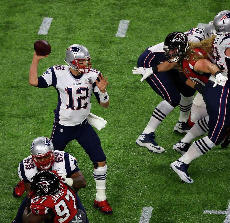 New England Patriots quarterback Tom Brady left, throws a pass during first half Super Bowl LI at NRG Stadium on Sunday, Feb. 5, 2017 in Houston. Photo: Michael Ciaglo, Houston Chronicle / Michael Ciaglo