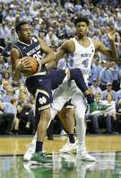 North Carolina's Isaiah Hicks and Notre Dame's Bonzie Colson (35) struggle for a rebound during the first half of an NCAA college basketball game in Greensboro, N.C., Sunday, Feb. 5, 2017. (AP Photo/Gerry Broome)