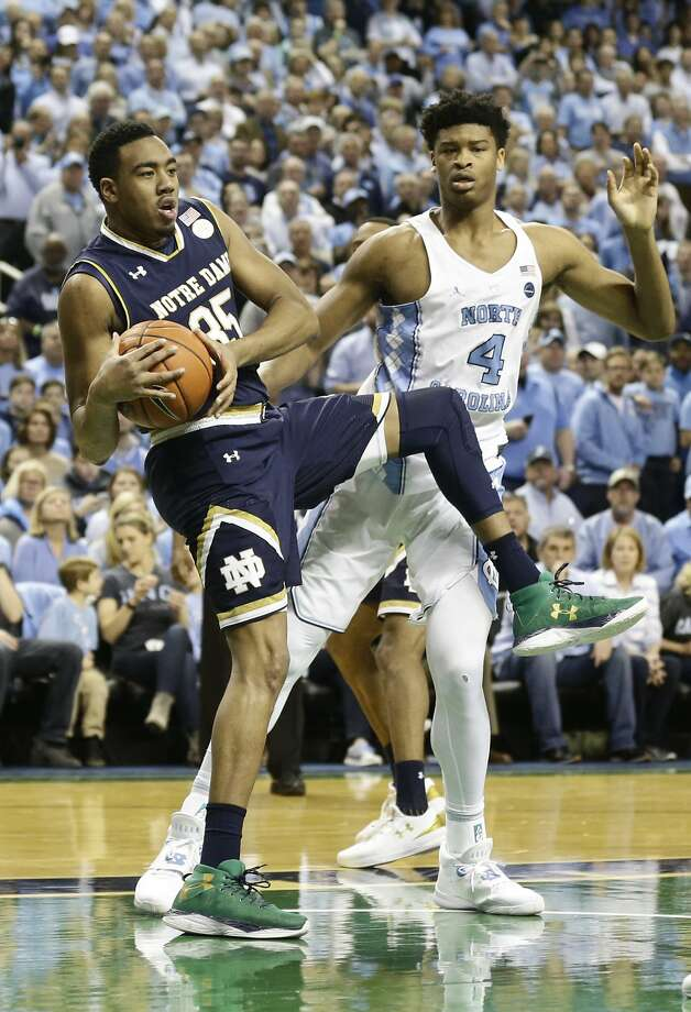 North Carolina's Isaiah Hicks (right) and Notre Dame's Bonzie Colson (35) struggle for a rebound. Photo: Gerry Broome, Associated Press
