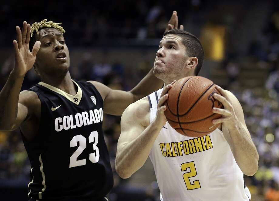California's Sam Singer, right, looks to shoot against Colorado's Bryce Peters (23) in the second half of an NCAA college basketball game Sunday, Feb. 5, 2017, in Berkeley, Calif. (AP Photo/Ben Margot) Photo: Ben Margot, Associated Press