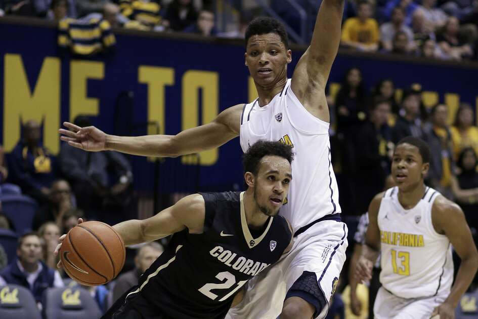 Colorado's Derrick White (21) drives the ball around California's Ivan Rabb in the first half of an NCAA college basketball game Sunday, Feb. 5, 2017, in Berkeley, Calif. (AP Photo/Ben Margot)