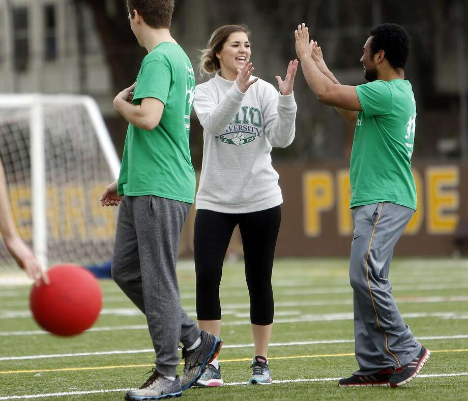 Megan McClain is congratulated after making a catch during a weekly co-ed kickball game organized by The League dating app in San Francisco, Calif., on Sunday, February 5, 2017. Photo: Scott Strazzante, The Chronicle