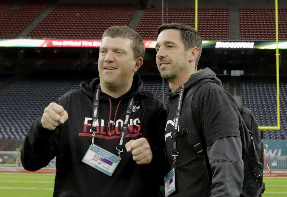 HOUSTON, TX - FEBRUARY 04: Offensive Coordinator Kyle Shanahan talks with a staff member during the Super Bowl LI team walk through at NRG Stadium on February 4, 2017 in Houston, Texas. (Photo by Tim Warner/Getty Images)