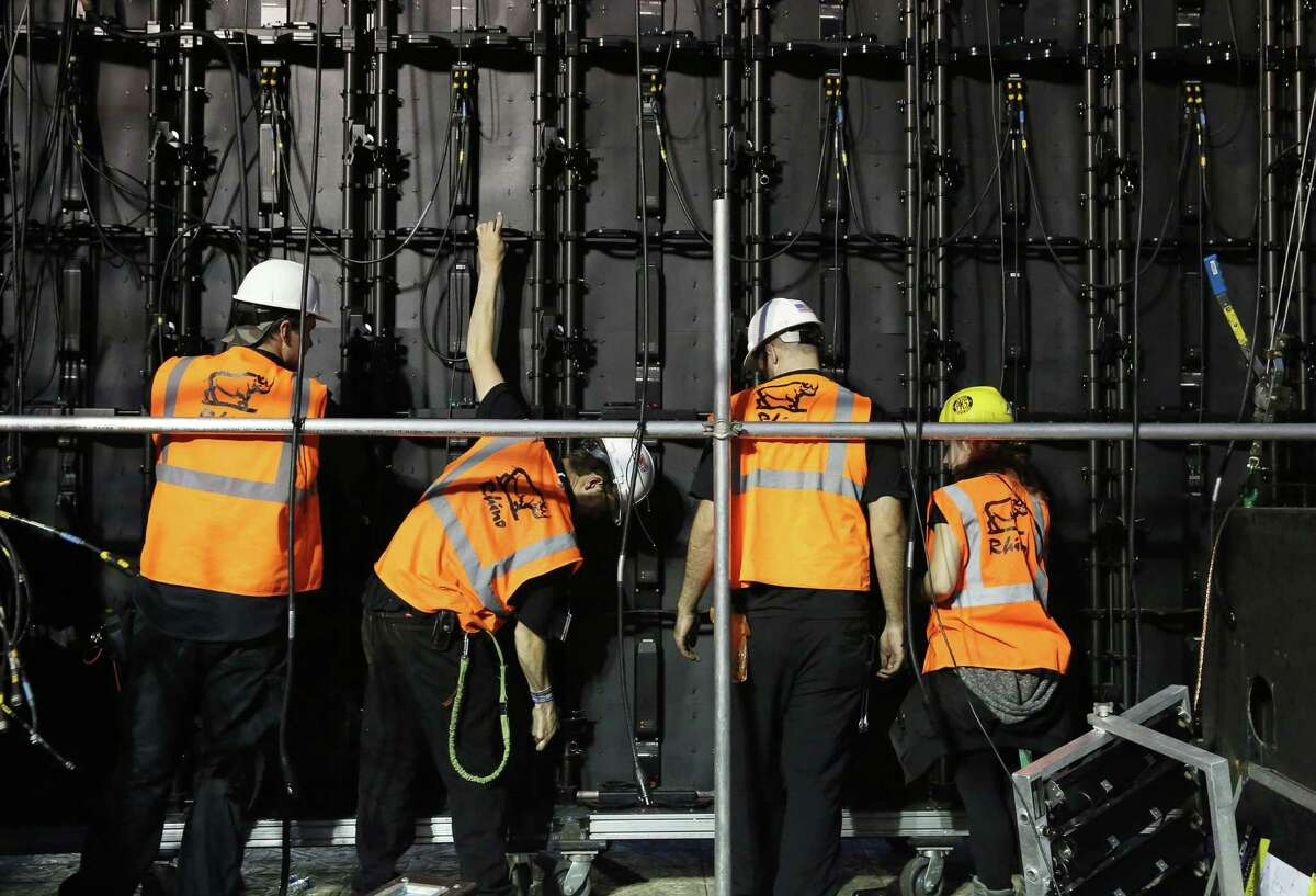 Workers taking down screen panels at the Fox Sports broadcasting area of the Super Bowl LIVE after the area was closed at 3 p.m. Sunday, Feb. 5, 2017, in Houston.