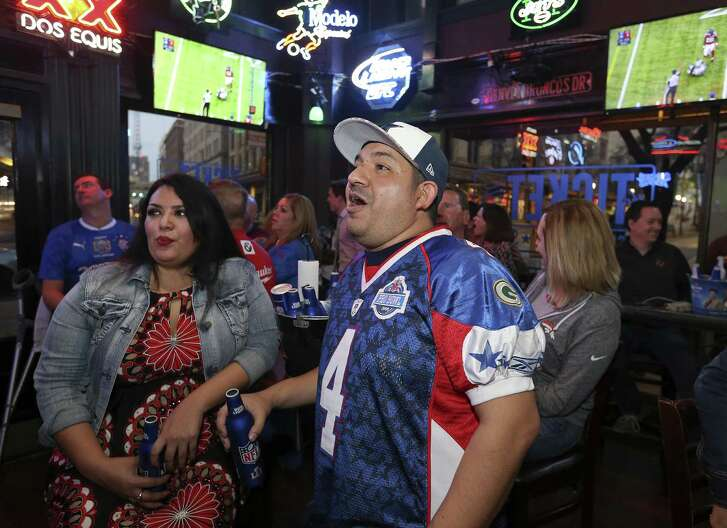 Falcons fan Camille Guerra, 34, and her husband Patriots fan Gus Guerra, 38 both of San Antonio, watch the Super Bowl Sunday Feb. 5, 2017 at The Ticket Sports Pub.