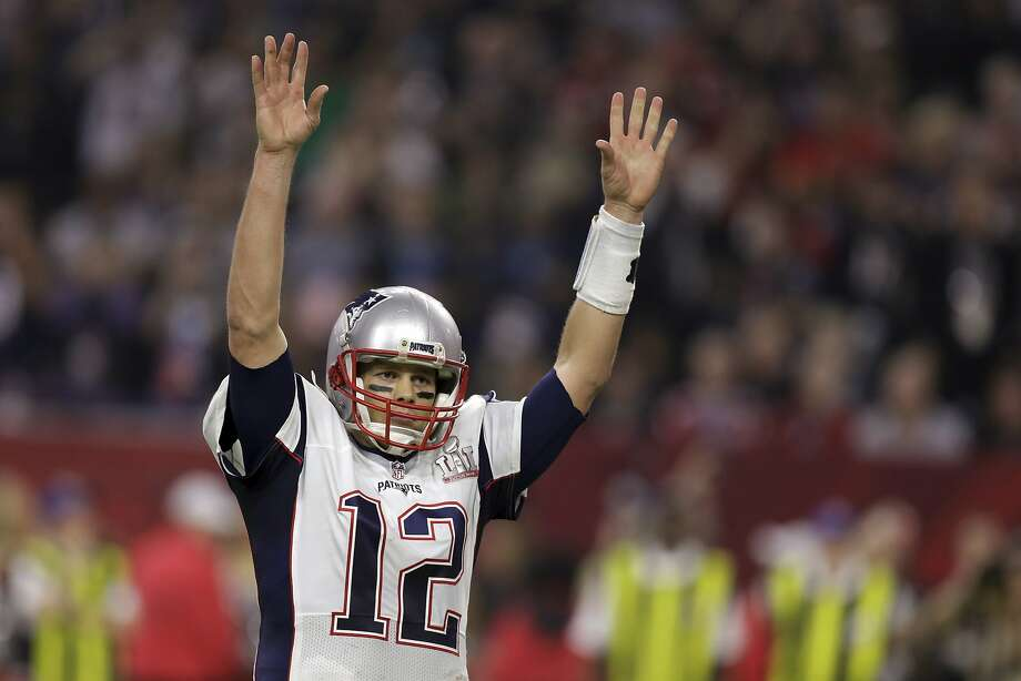 New England Patriots' Tom Brady raises his arms after scoring a touchdown during overtime of the NFL Super Bowl 51 football game against the Atlanta Falcons, Sunday, Feb. 5, 2017, in Houston. The Patriots defeated the Falcons 34-28. (AP Photo/Darron Cummings) Photo: Darron Cummings, Associated Press