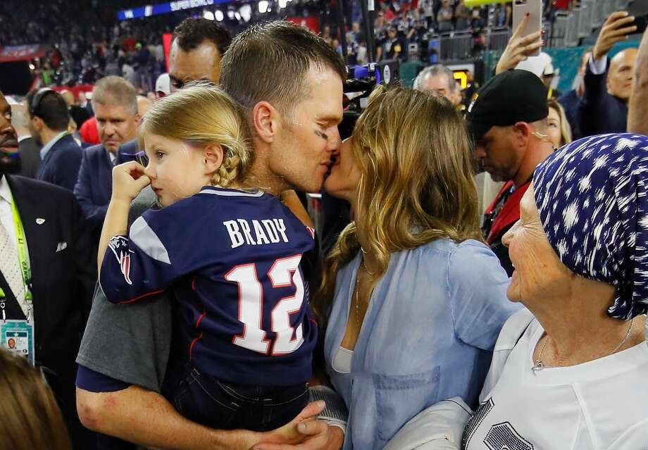 HOUSTON, TX - FEBRUARY 05:  Tom Brady #12 of the New England Patriots celebrates with wife Gisele Bundchen and daughter Vivian Brady after defeating the Atlanta Falcons during Super Bowl 51 at NRG Stadium on February 5, 2017 in Houston, Texas. The Patriots defeated the Falcons 34-28.  (Photo by Kevin C. Cox/Getty Images) Photo: Kevin C. Cox/Getty Images