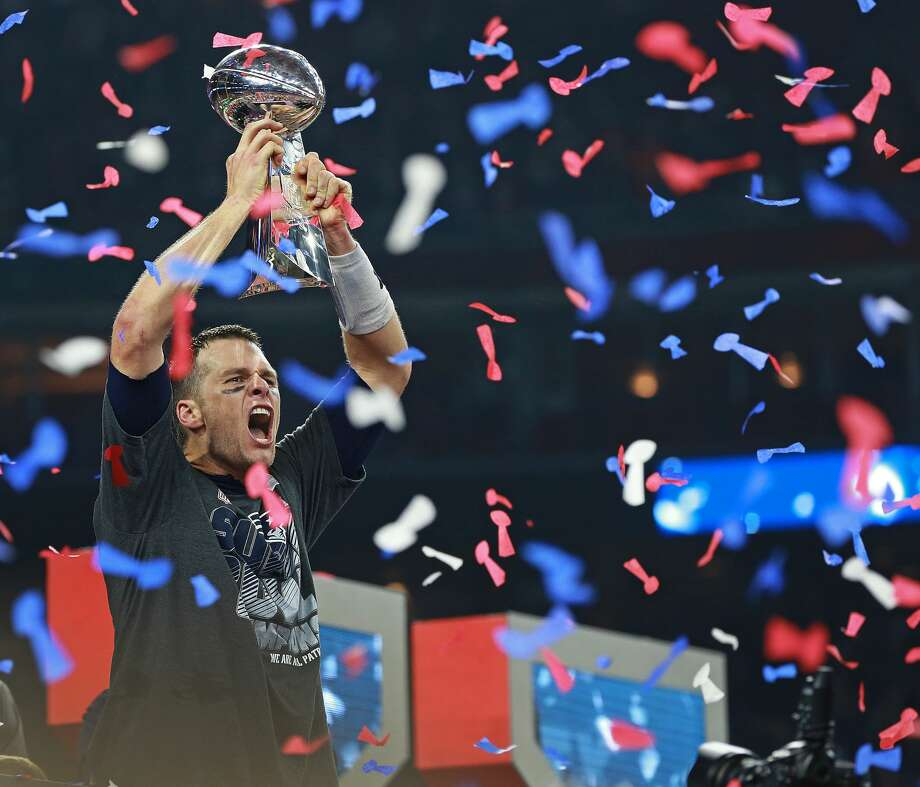 HOUSTON - FEBRUARY 5: As confetti falls around him, New England Patriots quarterback Tom Brady howls as he hoists the Vince Lombardi Trophy following New England's come-from-behind victory. The Atlanta Falcons play the New England Patriots in Super Bowl LI at NRG Stadium in Houston on Feb 5, 2017. (Photo by Jim Davis/The Boston Globe via Getty Images) Photo: Boston Globe/Boston Globe Via Getty Images
