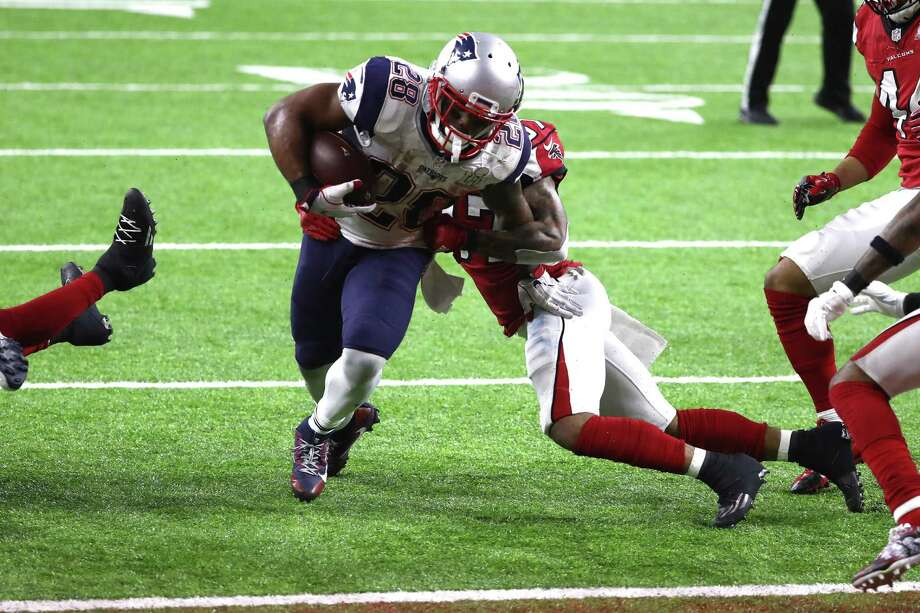 HOUSTON, TX - FEBRUARY 05:  James White #28 of the New England Patriots scores the game winning two yard touchdown in overtime against the Atlanta Falcons during Super Bowl 51 at NRG Stadium on February 5, 2017 in Houston, Texas.  (Photo by Elsa/Getty Images) Photo: Elsa, Staff / Getty Images / 2017 Getty Images
