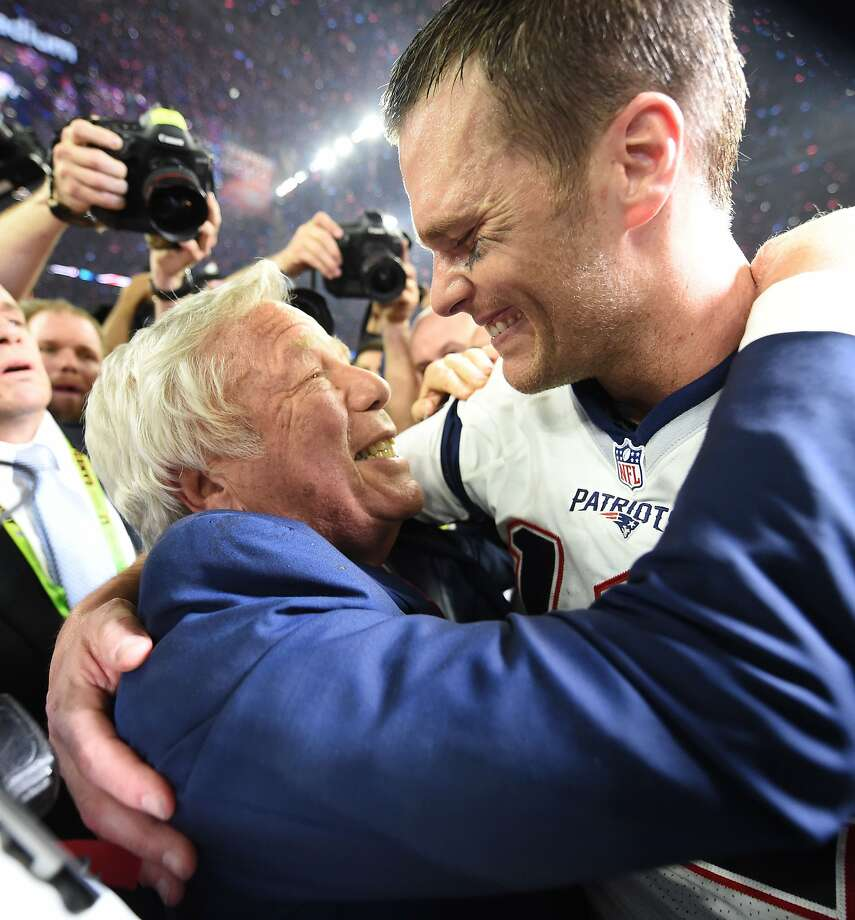 Patriots owner Robert Kraft and quarterback Tom Brady hug after their fifth Super Bowl championship together. Photo: TIMOTHY A. CLARY, AFP/Getty Images