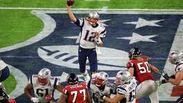 Patriots quarterback Tom Brady (12) threw for 466 yards and two touchdowns on Sunday to win Super Bowl Most Valuable Player honors for the fourth time.