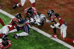 New England Patriots' James White scores the winning touchdown during overtime of the NFL Super Bowl 51 football game against the Atlanta Falcons, Sunday, Feb. 5, 2017, in Houston. (AP Photo/Charlie Riedel) ORG XMIT: NFL372