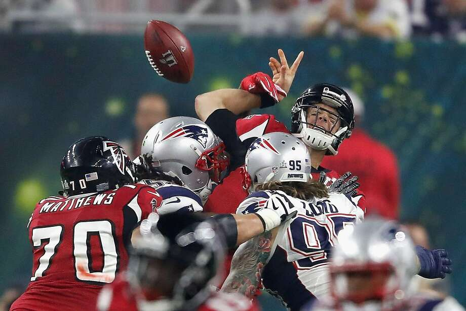 Falcons quarterback Matt Ryan is sacked by New England's Dont'a Hightower and fumbles on a 3rd-and-1 play in the fourth quarter Sunday. Photo: Gregory Shamus, Getty Images