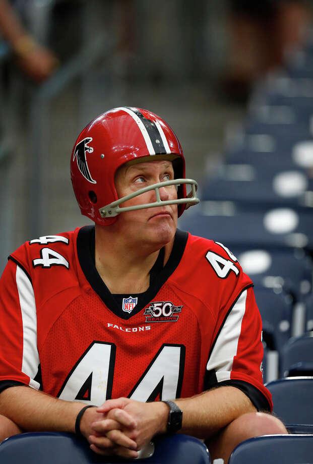An Atalanta Falcons fan sits in the stands before Super Bowl LI at NRG Stadium, Sunday, February 5, 2017. ( Karen Warren / Houston Chronicle ) Photo: Karen Warren/Houston Chronicle