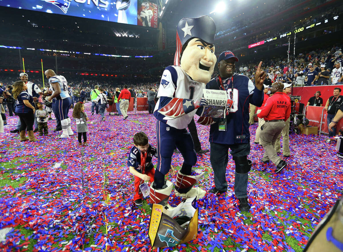New England Patriots fans celebrate after the Patriots defeated the Atlanta Falcons in Super Bowl LI at NRG Stadium on Sunday, February 5, 2017. ( Karen Warren / Houston Chronicle )