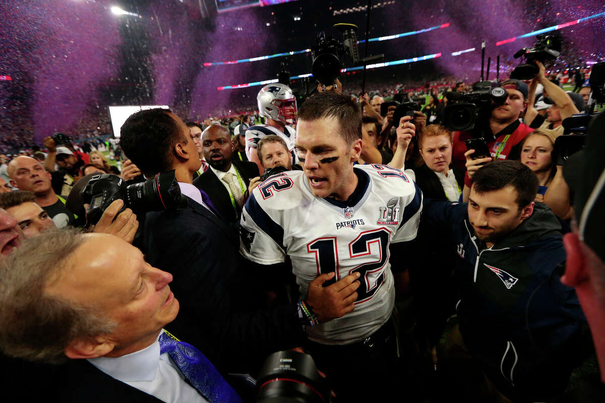 New England Patriots quarterback Tom Brady center, walks in the on field crowd after the Patriots defeated the Atlanta Falcons in Super Bowl LI at NRG Stadium on Sunday, Feb. 5, 2017, in Houston. ( Brett Coomer / Houston Chronicle )