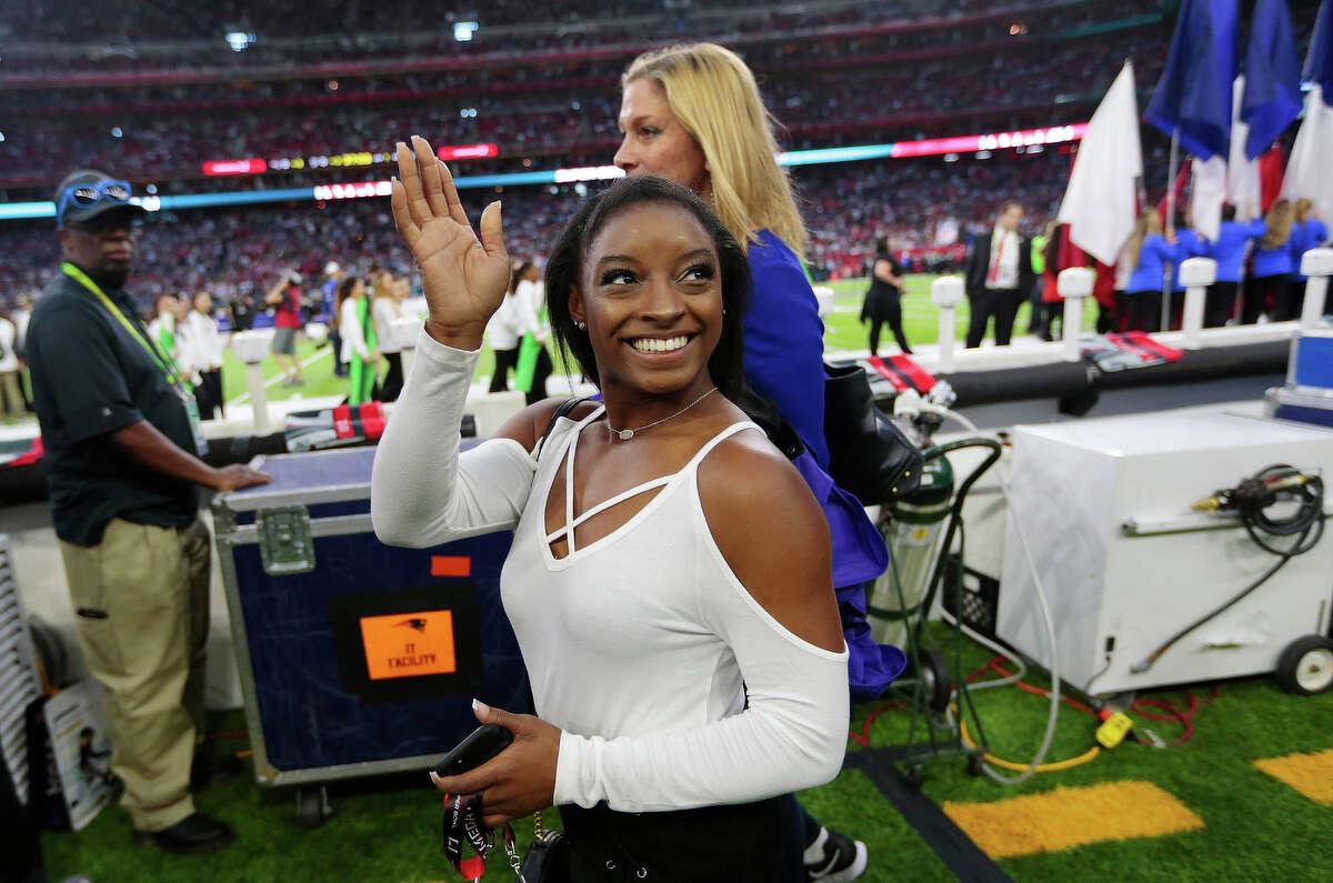 Simone Biles during pregame ceremonies of Super Bowl LI at NRG Stadium on Sunday, Feb. 5, 2017, in Houston. ( Brett Coomer / Houston Chronicle )