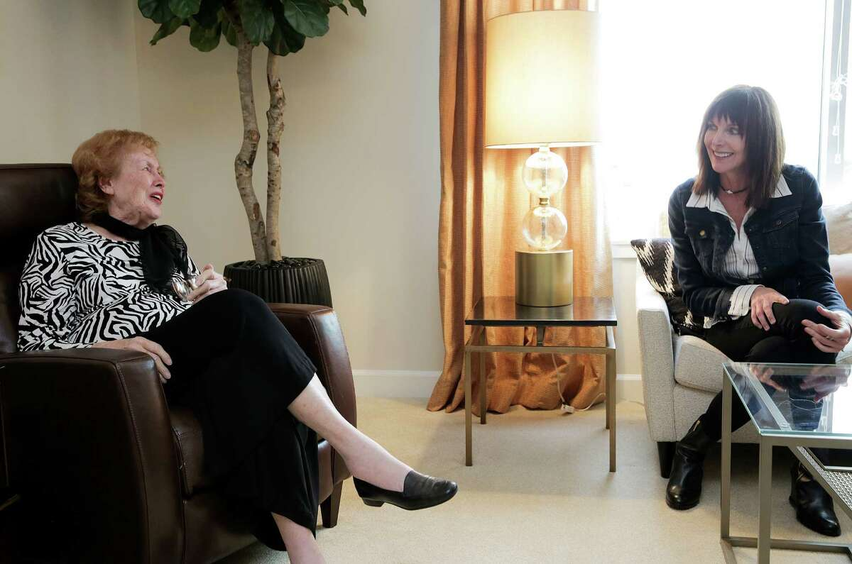 Margaret Paff, left, worked with interior designer Ann Schamberger of Ann P. Brennan Interior Design to turn her new home in Brazos Tower into a midcentury modern space.