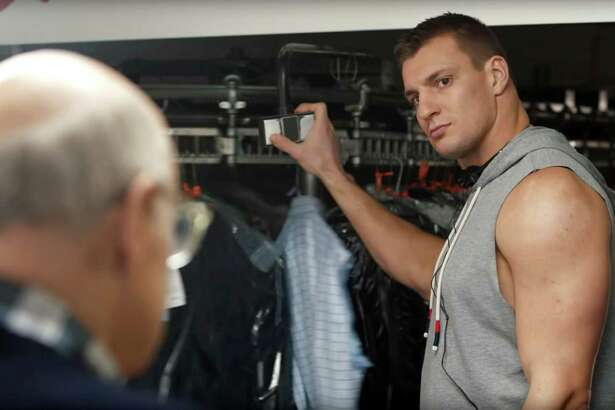"This frame grab from video provided by Procter & Gamble shows Rob Gronkowski, right, and Jeffrey Tambor in Tide's ""Gronk's Cleaners Discount"" Super Bowl 51 spot. The New England Patriots face the Atlanta Falcons in Super Bowl 51, on Sunday, Feb. 5, 2017. (Procter & Gamble via AP)"