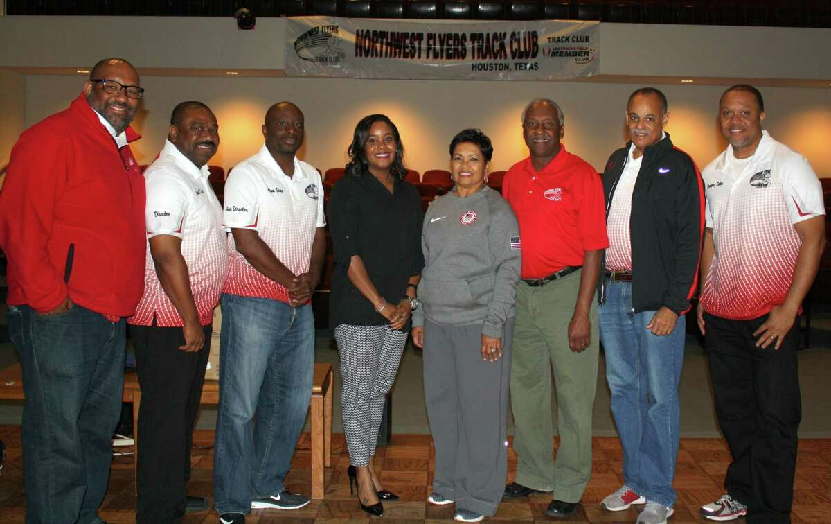 The Northwest Flyers' leadership poses together at the 30th Anniversary Celebration at the Cypress Creek Christian Community Center Forum Saturday. The Newhouses (center) were founding, inaugural members, and have watched the track and field organization swell from 13 members in 1987 to more than 200 per season, along with 22 coaches, today.