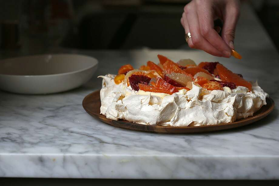 Top the pavlova with the citrus salad and salad and serve. Photo: Liz Hafalia, The Chronicle