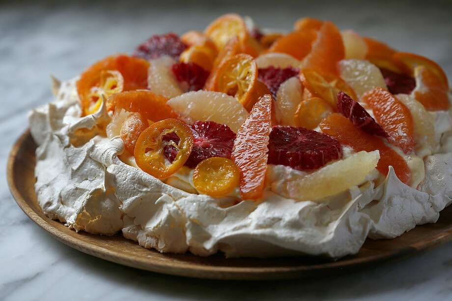 Pavlova With Lemon Curd & Citrus Salad Photo: Liz Hafalia, The Chronicle