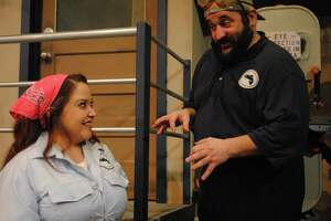 """Sarah Hamilton and John Boyd play employees of a failing fish packing plant in the Sheldon Vexler Theatre's staging of """"North Shore Fish."""""""