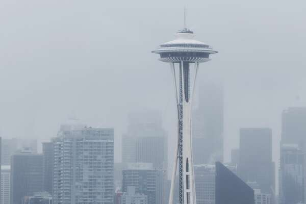 A snowy Space Needle stands out from Seattle's skyline after a few inches fell in the early hours of Monday, Feb. 6, 2017.