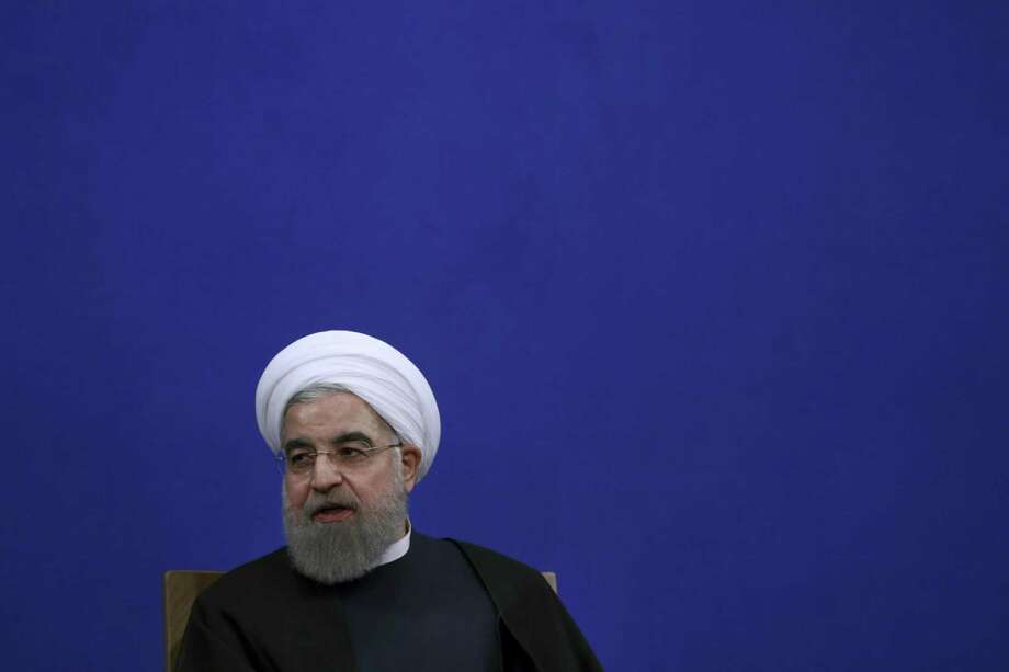 """Iranian President Hassan Rouhani speaks in a press conference at the presidency compound in Tehran, Iran, Tuesday, Jan. 17, 2017. Iran's president has compared talk of renegotiating its nuclear accord to """"converting a shirt back to cotton,"""" and says U.S. President-elect Donald Trump's talk of doing so is """"mainly slogans."""" (AP Photo/Vahid Salemi) Photo: Vahid Salemi, STR / Associated Press / Copyright 2017 The Associated Press. All rights reserved."""