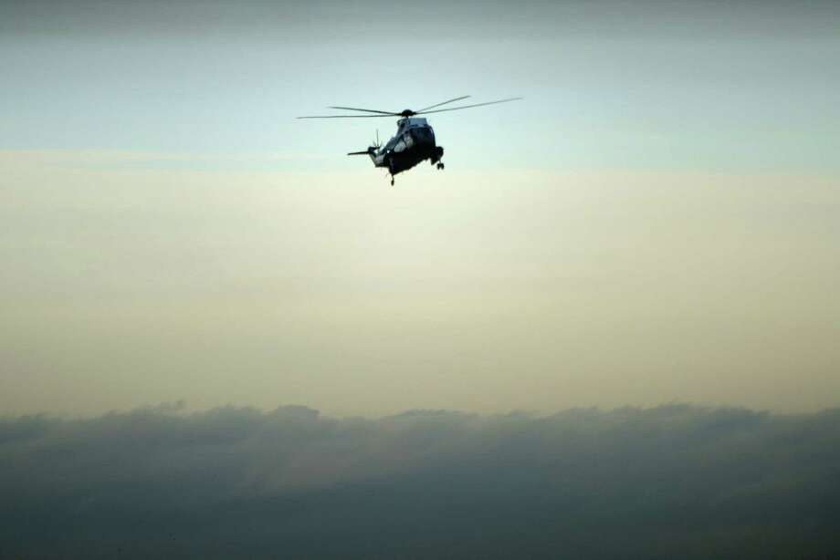 "Marine One with US President Donald Trump on board, lands at Dover Air Force Base February 1, 2017 in Dover, Delaware, for the dignified transfer of Navy Seal Chief Petty Officer William ""Ryan"" Owens who was killed in Yemen on January 29. / AFP PHOTO / Brendan SmialowskiBRENDAN SMIALOWSKI/AFP/Getty Images Photo: BRENDAN SMIALOWSKI, Staff / AFP/Getty Images / AFP or licensors"