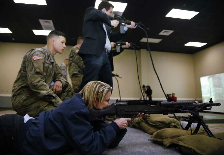 Sen. Dawn Buckingham, District 24, fires a M240G in a simulation during Texas Legislative Day at the military base in Fort Hood, Texas, on Friday, Feb. 3, 2017. State legislators toured the installation and were exposed to various training areas. (Eric J. Shelton/The Killeen Daily Herald via AP) Photo: Eric J. Shelton, MBO / Associated Press / KDH