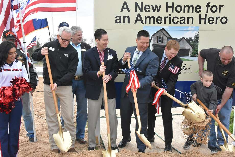 Roy Garcia (second from left with shovel), CFISD associate superintendent of school administration and leadership, joins representatives from The Howard Hughes Corporation, Beazer Homes, the Houston Texans and Operation Finally Home for a groundbreaking ceremony for U.S. Army Specialist Cliff Betcher, far right, and his family in the Bridgeland community on Jan. 27. Photo: N/a / Cy-Fair ISD