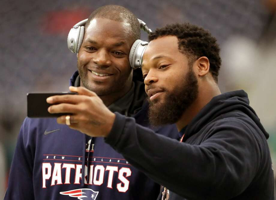 New England Patriots tight end Martellus Bennett (88) poses for a selfie with his brother Michael Bennett who plays for the Seattle Seahawks while on the field for pre game warm ups.  The Atlanta Falcons play the New England Patriots in Super Bowl LI at NRG Stadium in Houston on Feb. 5, 2017. (Photo by Barry Chin/The Boston Globe via Getty Images) Photo: Boston Globe/Boston Globe Via Getty Images