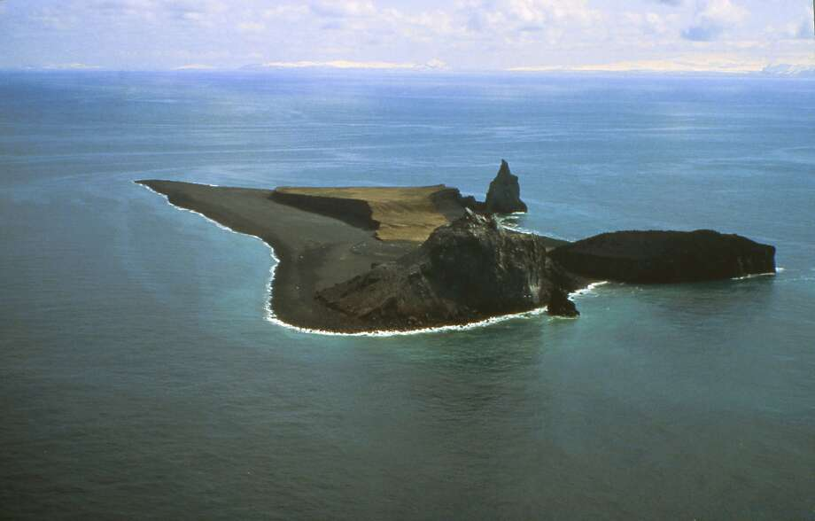 A 1994 aerial photo shows Bogoslof Island, Alaska. Since December, the volcano has erupted more than two dozen times. Photo: T. Keith, Associated Press