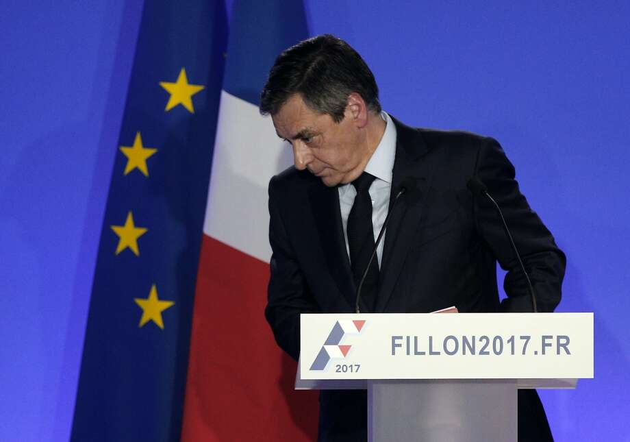 Conservative Francois Fillon is being investigated for political jobs he gave his wife, son and daughter. Photo: Christophe Ena, Associated Press
