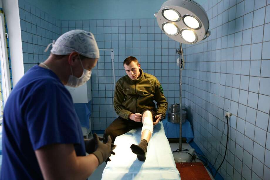 A surgeon treats a wounded Ukrainian soldier in the town of Pokrovske in the Donetsk region on Sunday. Photo: ALEKSEY FILIPPOV, AFP/Getty Images