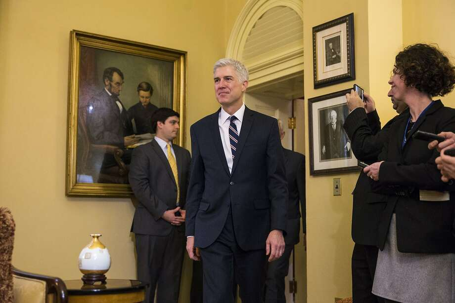 FILE -- Judge Neil Gorsuch, President Donald Trump's pick for the Supreme Court vacancy, arrives to meet with Vice President Mike Pence and Senate Majority Leader Mitch McConnell (R-Ky.), on Capitol Hill, in Washington, Feb. 1, 2017. After witnessing his mother's public career in politics be destroyed in an ugly showdown with Congress during the Reagan era, Gorsuch's own moment of testing has arrived during political culture even more caustic. (Al Drago/The New York Times) Photo: AL DRAGO, NYT