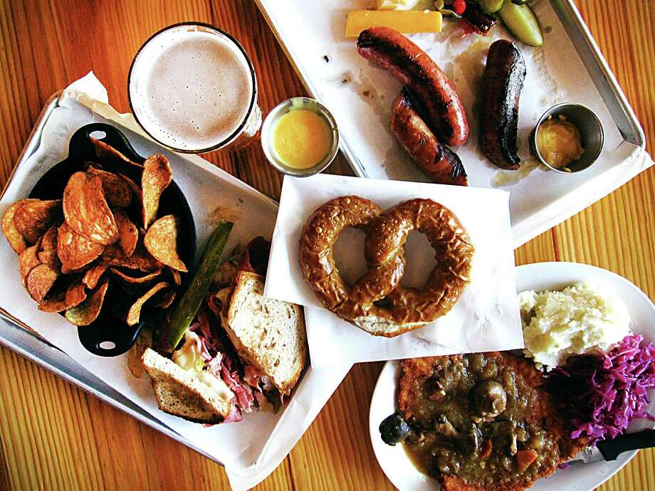 An array of dishes from the new Krause's Cafe in New Braunfels. Clockwise from left: A Reuben sandwich with house-fried potato chips, a sausage sampler with pickles and cheese, jägerschnitzel with mushroom gravy, mashed potatoes and red cabbage and a pretzel with beer cheese (center). Photo: Mike Sutter /San Antonio Express-News